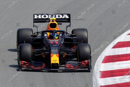 Red Bull driver Sergio Perez of Mexico takes a curve during the second free practice for the Spanish Formula One Grand Prix at the Barcelona Catalunya racetrack in Montmelo, just outside Barcelona, Spain, . The Spanish Grand Prix will be held on Sunday