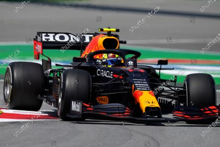 Red Bull driver Sergio Perez of Mexico takes a curve during the first free practice for the Spanish Formula One Grand Prix at the Barcelona Catalunya racetrack in Montmelo, just outside Barcelona, Spain, . The Spanish Grand Prix will be held on Sunday