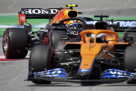 Red Bull driver Sergio Perez of Mexico follows Mclaren driver Daniel Ricciardo of Australia, right, through a curve during the first free practice for the Spanish Formula One Grand Prix at the Barcelona Catalunya racetrack in Montmelo, just outside Barcelona, Spain, . The Spanish Grand Prix will be held on Sunday