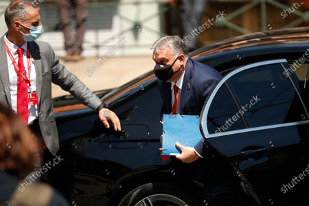 Hungary's Prime Minister Viktor Orban arrives for an EU summit at the Alfandega do Porto Congress Center in Porto, Portugal, . European Union leaders are meeting for a summit in Portugal on Friday, sending a signal they see the threat from COVID-19 on their continent as waning amid a quickening vaccine rollout. Their talks hope to repair some of the damage the coronavirus has caused in the bloc, in such areas as welfare and employment