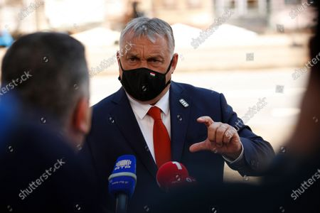 Hungary's Prime Minister Viktor Orban speaks with the media as he arrives for an EU summit at the Alfandega do Porto Congress Center in Porto, Portugal, . European Union leaders are meeting for a summit in Portugal on Friday, sending a signal they see the threat from COVID-19 on their continent as waning amid a quickening vaccine rollout. Their talks hope to repair some of the damage the coronavirus has caused in the bloc, in such areas as welfare and employment