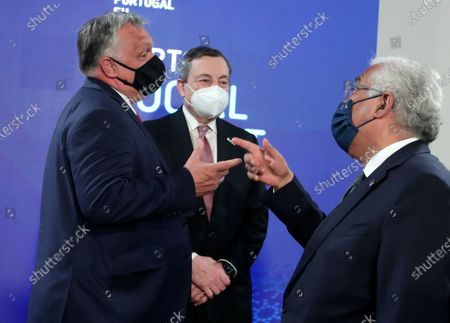 Portugal's Prime Minister Antonio Costa, right, speaks with Hungary's Prime Minister Viktor Orban, left, and Italy's Prime Minister Mario Draghi, center, during the opening ceremony of an EU summit at the Alfandega do Porto Congress Center in Porto, Portugal, . European Union leaders are meeting for a summit in Portugal on Friday, sending a signal they see the threat from COVID-19 on their continent as waning amid a quickening vaccine rollout. Their talks hope to repair some of the damage the coronavirus has caused in the bloc, in such areas as welfare and employment