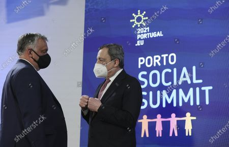 Stock Image of Hungary's Prime Minister Viktor Orban, left, speaks with Italy's Prime Minister Mario Draghi during the opening ceremony of an EU summit at the Alfandega do Porto Congress Center in Porto, Portugal, . European Union leaders are meeting for a summit in Portugal on Friday, sending a signal they see the threat from COVID-19 on their continent as waning amid a quickening vaccine rollout. Their talks hope to repair some of the damage the coronavirus has caused in the bloc, in such areas as welfare and employment