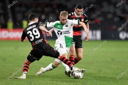 Stock Photo of Connor Pain of Western United squeezes past Thomas Aquilina and Graham Dorrans of Western Sydney Wanderers; Bankwest Stadium, Parramatta, New South Wales, Australia; A League Football, Western Sydney Wanderers versus Western United.