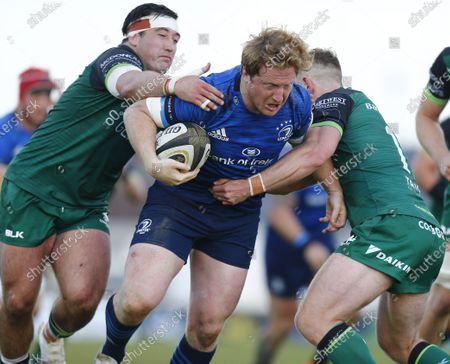 James Tracy (Leinster) bursts through Denis Buckley and Matt Healy (Connacht); Galway Sportsgrounds, Galway, Connacht, Ireland; Rainbow Cup Rugby, Connacht versus Leinster.