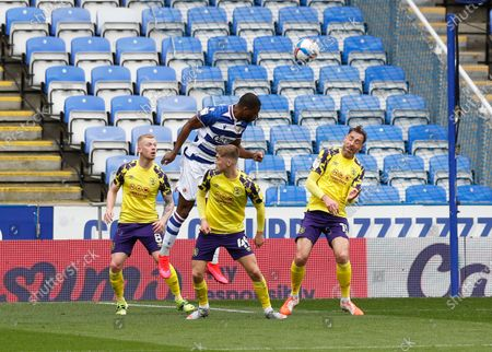 Stock Picture of Yakou Meite of Reading leaps to head the ball over Scott High, Lewis O'Brien and Richard Keoghof Huddersfield Town to score his sides 2nd goal in the 26th minute to make it 2-1; Madejski Stadium, Reading, Berkshire, England; English Football League Championship Football, Reading versus Huddersfield Town.