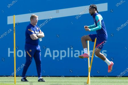 FC Barcelona's head coach Ronald Koeman (L) and Brazilian midfielder Matheus Fernandes (R) during a training session at Joan Gamper Sports City, in Barcelona, Spain, 07 May 2021. FC Barcelona will be facing Atletico de Madrid 08 May 2021 at Camp Nou stadium in a Spanish LaLiga match.
