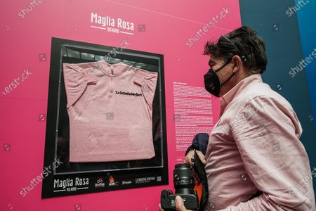 A visitor looks at the Maglia Rosa of Italian cycling legend Fausto Coppi, exhibited at the Museo Egizio in Turin, Italy, 07 May 2021. The Giro d'Italia overall leader's pink jersey celebrates its 90th anniversary. The 104th edition of the Giro d'Italia will take place from 08 May through 30 May 2021.