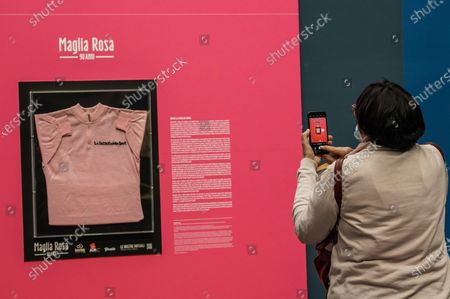Stock Picture of A visitor takes a picture of the Maglia Rosa of Italian cycling legend Fausto Coppi, exhibited at the Museo Egizio in Turin, Italy, 07 May 2021. The Giro d'Italia overall leader's pink jersey celebrates its 90th anniversary. The 104th edition of the Giro d'Italia will take place from 08 May through 30 May 2021.