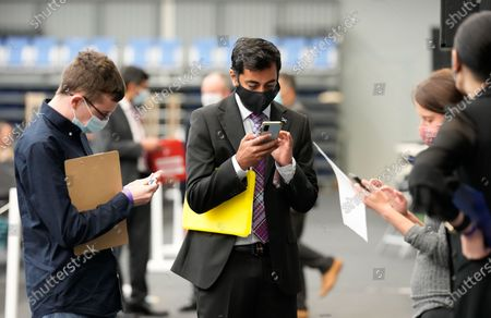 Stock Picture of Humza Yousaf SNP Cabinet Secretary for Justice looks at his mobile phone at the Scottish Election 2021 count.