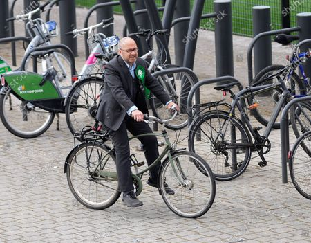 Scottish Green Party Co-leader Patrick Harvie arrives at the Scottish Election 2021 count at The Emirates Arena on his bicycle.
