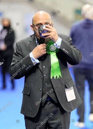Stock Photo of Scottish Green Party Co-leader Patrick Harvie drinks from a cup on the counting floor at the Scottish Election 2021 Glasgow count.
