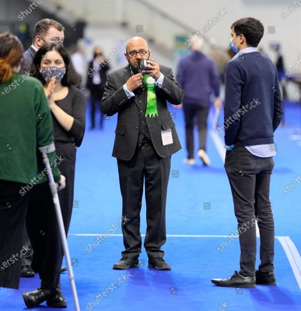 Scottish Green Party Co-leader Patrick Harvie drinks from a cup on the counting floor at the Scottish Election 2021 Glasgow count.