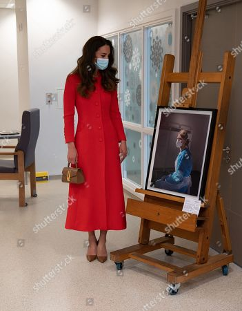 Catherine Duchess of Cambridge visited the Royal London Hospital Whitechapel During the visit, The Duchess heard about how the hospital uses art to benefit its staff and patients, before meeting a small group of hospital staff and heard about their experiences over the past year. Director of Arts and health shows the Duchess the artwork on display