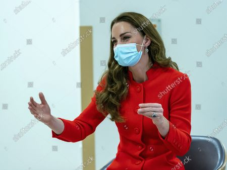"""Britain's Kate, Duchess of Cambridge speaks during a visit to Royal London Hospital in Whitechapel, east London, to mark the publication of the book """"Hold Still"""