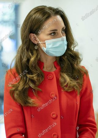 """Britain's Kate, Duchess of Cambridge during a visit to Royal London Hospital in Whitechapel, east London, to mark the publication of the book """"Hold Still"""