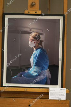 """Photograph of nurse Melanie Senior, taken by Johanna Churchill, is on display at the Royal London Hospital in Whitechapel, east London, during a visit by Kate, Duchess of Cambridge to mark the publication of the book """"Hold Still"""