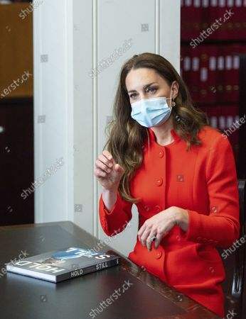 Britain's Kate, Duchess of Cambridge talks to 'Hold Still' entrants during a visit to the archive in the National Portrait Gallery in central London, to mark the publication of the book 'Hold Still