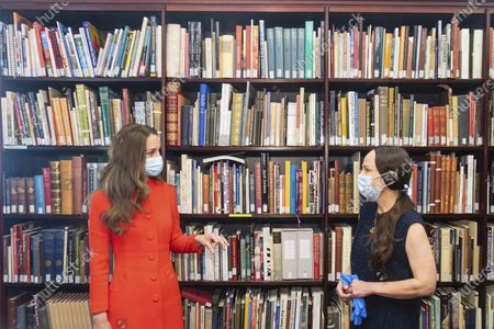 Britain's Kate, Duchess of Cambridge speaks with Curator Magda Keaney during a visit to the archive in the National Portrait Gallery in central London, to mark the publication of the book 'Hold Still