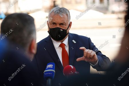 Hungary's Prime Minister Viktor Orban speaks with the media as he arrives for an EU summit at the Alfandega do Porto Congress Center in Porto, Portugal, 07 May 2021. European Union leaders are meeting for a summit in Portugal, sending a signal they see the threat from COVID-19 on their continent as waning amid a quickening vaccine rollout. Their talks hope to repair some of the damage the coronavirus has caused in the bloc, in such areas as welfare and employment.