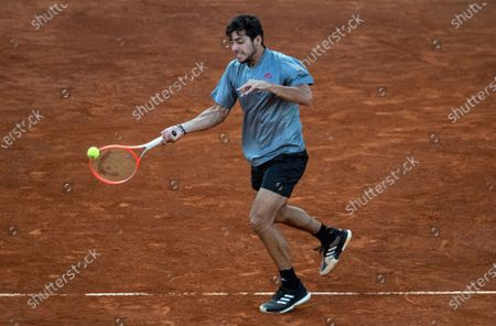 Christian Garin of Chile in action against Matteo Berrettini of Italy during their Mutua Madrid Open quarter final match against held in Madrid, Spain, 07 May 2021.