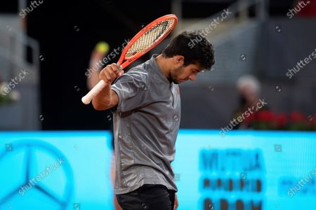 Stock Image of Christian Garin of Chile reacts against Matteo Berrettini of Italy during the Mutua Madrid Open quarter final match held in Madrid, Spain, 07 May 2021.
