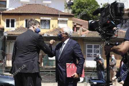 Stock Image of Portuguese Prime Minister Antonio Costa (R) and EU Commission Vice-President Valdis Dombrovskis (L) arrive at an EU summit at the Alfandega do Porto Congress Center in Porto, Portugal, 07 May 2021. European Union leaders are meeting for a summit in Portugal, sending a signal they see the threat from COVID-19 on their continent as waning amid a quickening vaccine rollout. Their talks hope to repair some of the damage the coronavirus has caused in the bloc, in such areas as welfare and employment.