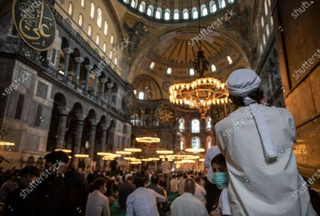 People attend last Friday prayer of Ramadan in the Hagia Sophia Mosque during the lockdown in Istanbul, Turkey, 07 May 2021. Turkish President Recep Tayyip Erdogan announced a total lockdown between 30 April to 17 May due to increased COVID-19 cases. The lockdown coincides with the festival of Eid al-Fitr, which marks the end of the Muslim fasting month of Ramadan. The toll from coronavirus-related deaths has risen in Turkey to 39,737 people in total as of 28 April 2021, with the country reporting 4,788,700 confirmed cases.