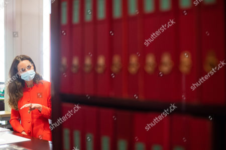 Catherine Duchess of Cambridge during a visit to the archive in the National Portrait Gallery in central London to mark the publication of the 'Hold Still' book.