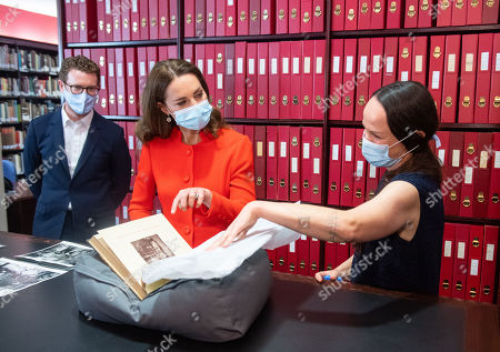 Catherine Duchess of Cambridge views archive photos alongside Curator Magda Keaney and Director of the National Portrait Gallery Nick Cullinan (left) during a visit to the archive in the National Portrait Gallery in central London to mark the publication of the 'Hold Still' book.
