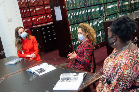 Stock Photo of Catherine Duchess of Cambridge talks to 'Hold Still' entrants Naz Maleknia (centre) and Claudia Burton (right) during a visit to the archive in the National Portrait Gallery in central London to mark the publication of the 'Hold Still' book.