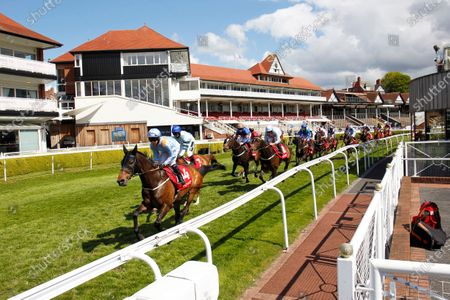 Runners head past the empty stands in the Chester Cup 1st circuit with winner Falcon Eight and Frankie Dettori.