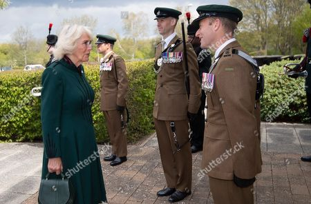 Stock Photo of Camilla Duchess of Cornwall, Colonel-in-Chief,The Rifles,will undertake her first visit to 5thBattalion The Rifles, following her new appointment asColonel-in-Chief.  Her Royal Highness will be greeted with a Royal Fanfare on arrival at the barracks.The Duchess will then receive a short private briefing by The Commanding Officer,Lieutenant ColonelJim Hadfield MBE. The Duchess will then meet with Riflemen and their familiesat a small reception (outside).During the reception Her Royal Highnesswill meet Riflemen who have recentlyreturned from Estonia(Operation CABRIT 7) and other Riflemen and families that remained in the UK over the tour.This group were instrumental in the success of the Battalion in Estonia, providing unwavering support.The Duchesswill also present a small numberof non-operational medals.Following the reception, The Commanding Officerwill say a few words before Her Royal Highness departs. PIC: The Duchess meets Lieutenant ColonelJim Hadfield MBE.