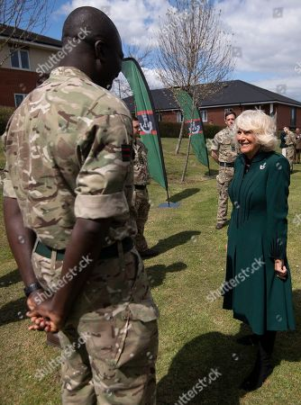 Camilla Duchess of Cornwall, Colonel-in-Chief,The Rifles,will undertake her first visit to 5thBattalion The Rifles, following her new appointment asColonel-in-Chief.  Her Royal Highness will be greeted with a Royal Fanfare on arrival at the barracks.The Duchess will then receive a short private briefing by The Commanding Officer,Lieutenant ColonelJim Hadfield MBE. The Duchess will then meet with Riflemen and their familiesat a small reception (outside).During the reception Her Royal Highnesswill meet Riflemen who have recentlyreturned from Estonia(Operation CABRIT 7) and other Riflemen and families that remained in the UK over the tour.This group were instrumental in the success of the Battalion in Estonia, providing unwavering support.The Duchesswill also present a small numberof non-operational medals.Following the reception, The Commanding Officerwill say a few words before Her Royal Highness departs. PIC: The Duchess meets Colour Serjeant Jerry Wiredu.
