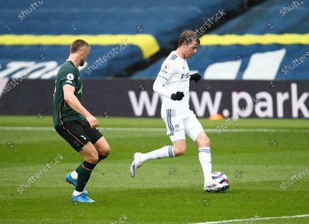 Patrick Bamford of Leeds United and Eric Dier of Tottenham Hotspur