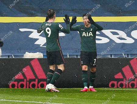 Son Heung-Min of Tottenham Hotspur celebrates scoring a goal to make it 1-1 with Gareth Bale