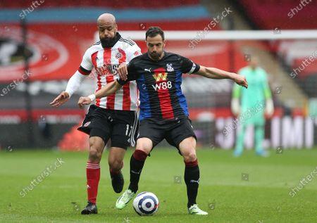 Stock Photo of David McGoldrick of Sheffield United battles with Crystal Palace's Luka Milivojevic