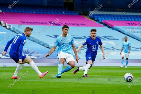 Stock Image of Rodrigo of Manchester City under pressure from Timo Werner of Chelsea and Billy Gilmour of Chelsea