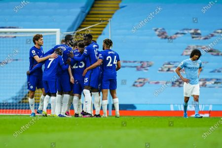 Hakim Ziyech of Chelsea celebrates scoring a goal with his teammates to make it 1-1