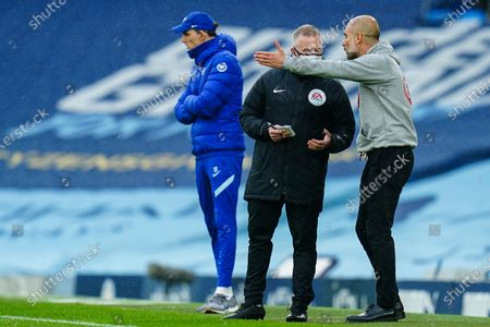 Manchester City Manager Pep Guardiola argues with the fourth official Jon Moss