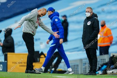 Manchester City Manager Pep Guardiola complains to the fourth official Jon Moss after a penalty to Manchester City was not given