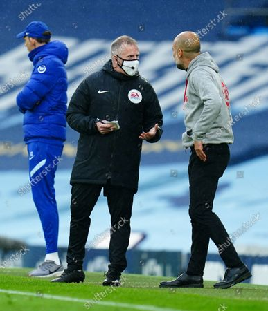 Fourth official Jon Moss remonstrates with Manchester City Manager Pep Guardiola after a late penalty incident involving Raheem Sterling