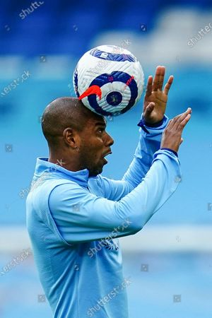 Fernandinho of Manchester City balances the ball on his head as he warms up before kick off