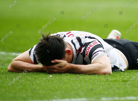 Harry Maguire of Manchester United goes down after taking a knock