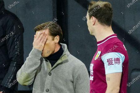 Fulham manager Scott Parker reacts dejectedly on the sideline alongside Ashley Barnes of Burnley