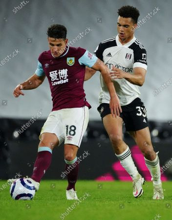 Ashley Westwood of Burnley is challenged by Antonee Robinson of Fulham
