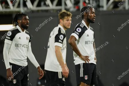Josh Onomah of Fulham reacts alongside Joachim Andersen of Fulham and Andre Frank Zambo Anguissa of Fulham
