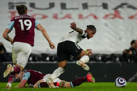 Ivan Cavaleiro of Fulham wins the ball off Matej Vydra of Burnley