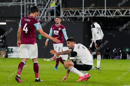 Aleksander Mitrovic of Fulham is consoled by Jack Cork of Burnley at full-time as the 0-2 loss means Fulham are relegated from the Premier League