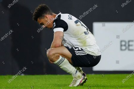 Antonee Robinson of Fulham reacts on the ground at full-time as Fulham are relegated from the Premier League